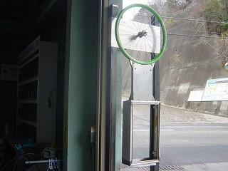 昇降扉駆動自転車輪軸看板